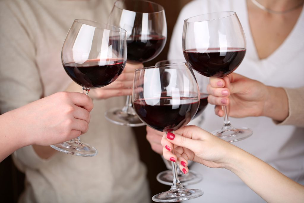 35885506 - woman hands with glasses of wine close-up