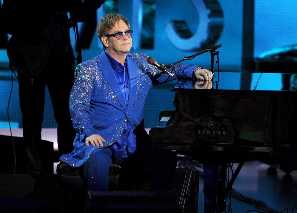 LOS ANGELES, CA - SEPTEMBER 22:  Recording artist Elton John performs onstage during the 65th Annual Primetime Emmy Awards held at Nokia Theatre L.A. Live on September 22, 2013 in Los Angeles, California.  (Photo by Kevin Winter/Getty Images)