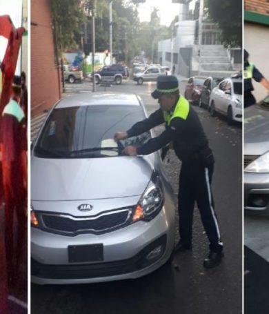 Agentes multan a conductores y llevan con grúa coches mal estacionados frente al Cristo Rey